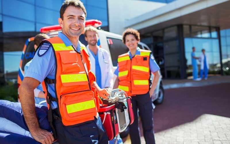 Emergency Staff outside an ER entrance